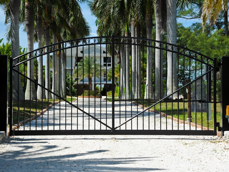 Decorative Black Metal Gate At The Driveway Entrance