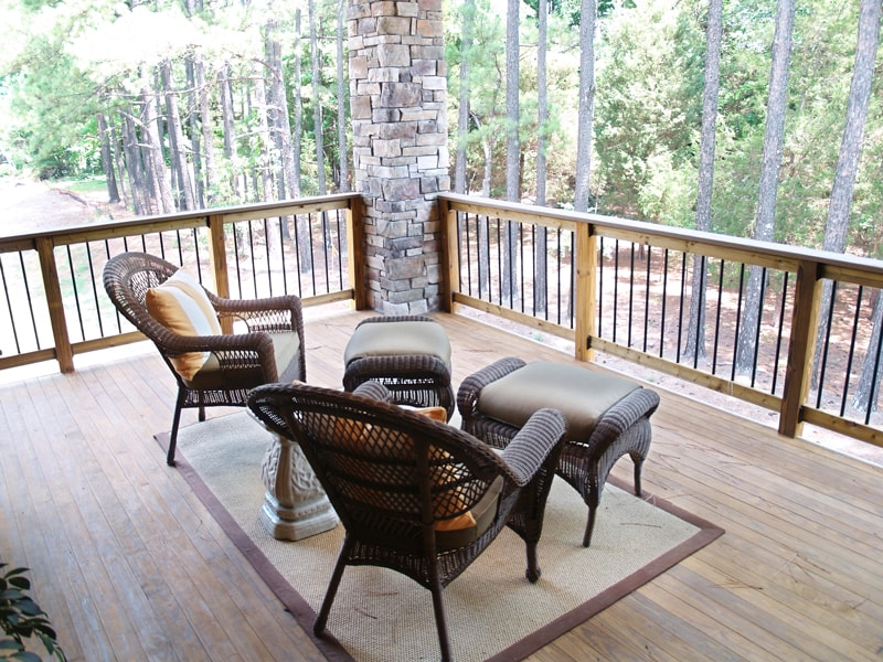 Custom Black Iron Rod And Wood Handrail On Porch Deck